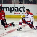 Troy Brouwer stretches in tandem with Chicago's Dylan Olsen. It may have been a coincidence. (Ben Sumner)