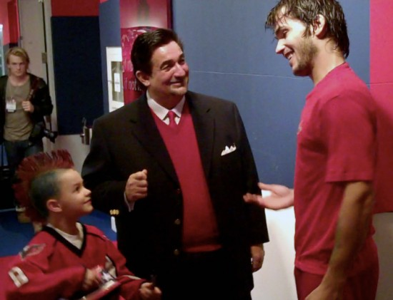 Leonsis introduces his guest to Jose Theodore